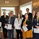 Business professionals inducted into Sigma Chi Mu Tau
